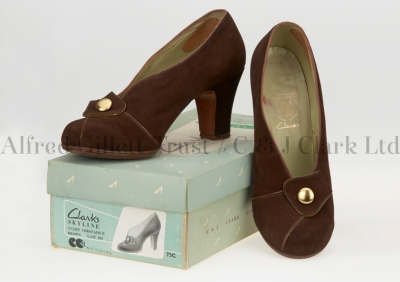 Cover shot showing a pair of women's brown suede/leather slip-on shoes with their original box; Clarks Skyline 'Coronado', 1949 ©Alfred Gillett Trust / C & J Clark Ltd