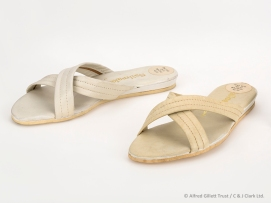 Pair women's cream leather backless sandals held on by 2 bars crossing over; Clarks Sailmakers 'Brioni', 1966